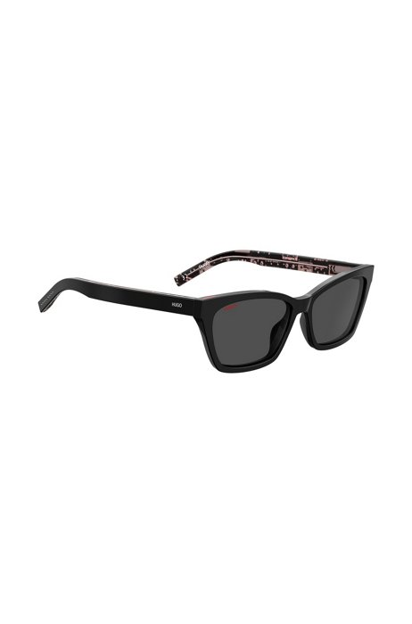 Cateye-zonnebril in het zwart met cassettebandjesprint, Zwart