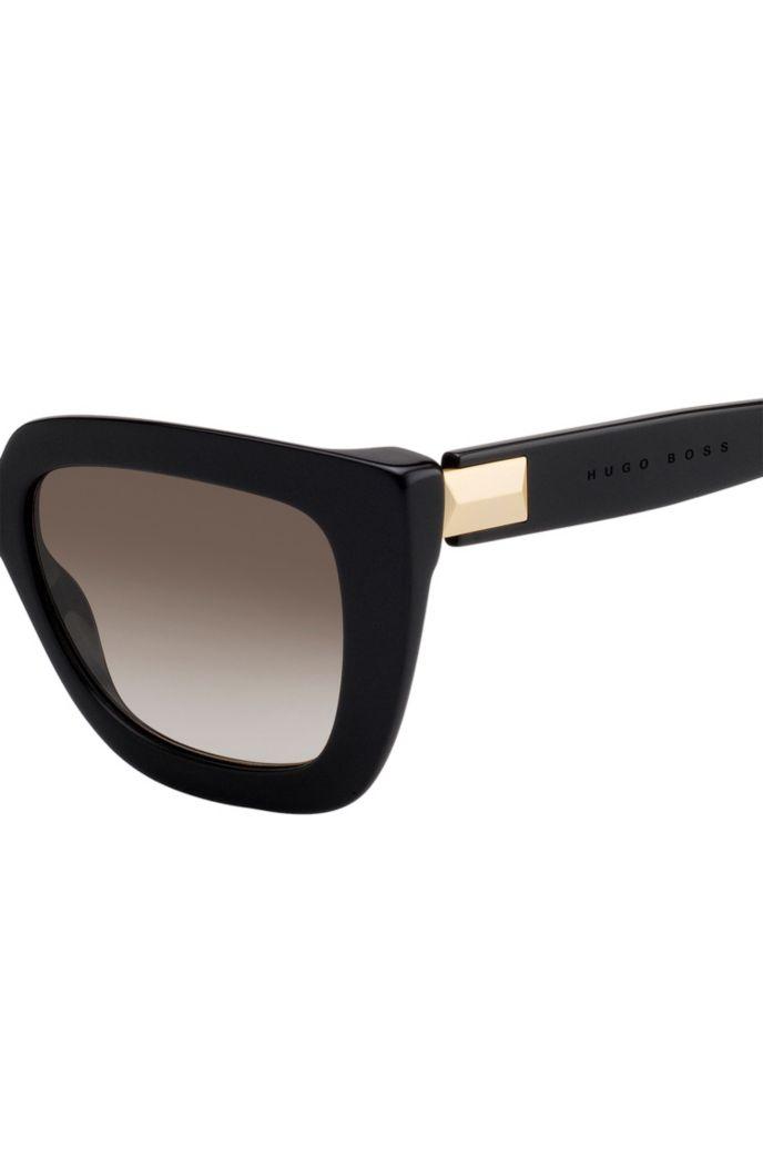 Zonnebril van zwart acetaat met hardwaredetail