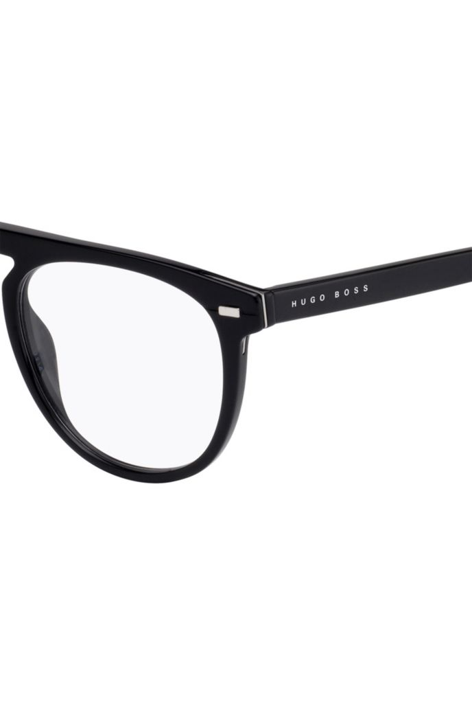 Optical frames in black acetate with hardware details