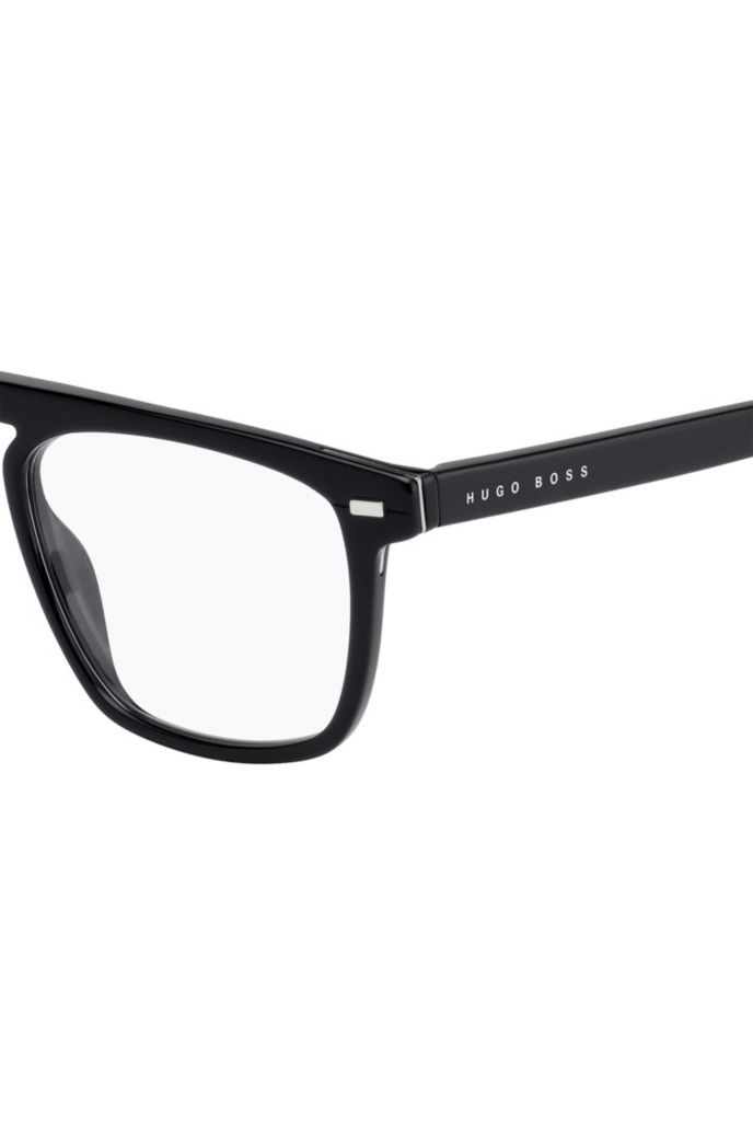 Optical frames in black acetate with hardware rivets