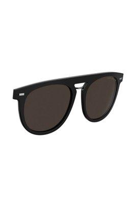 Clip-on zonnebril in een rond model van zwart acetaat, Zwart