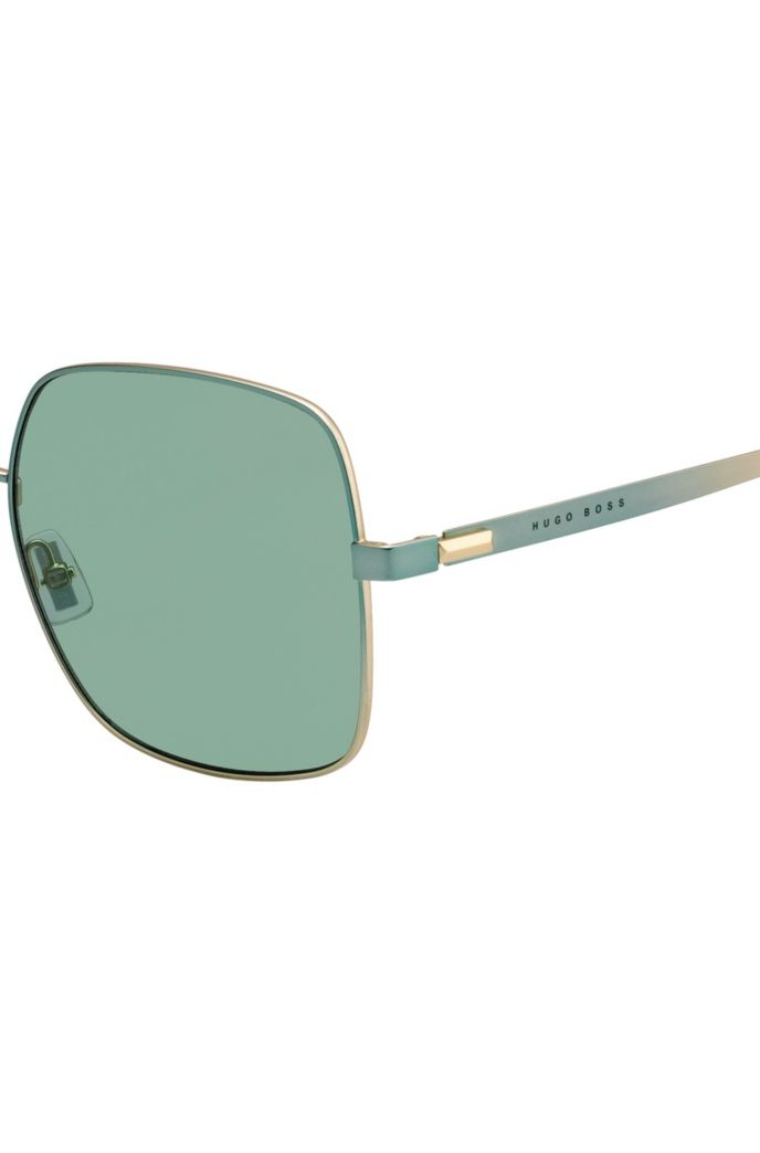 Green sunglasses with pyramid-shaped hardware