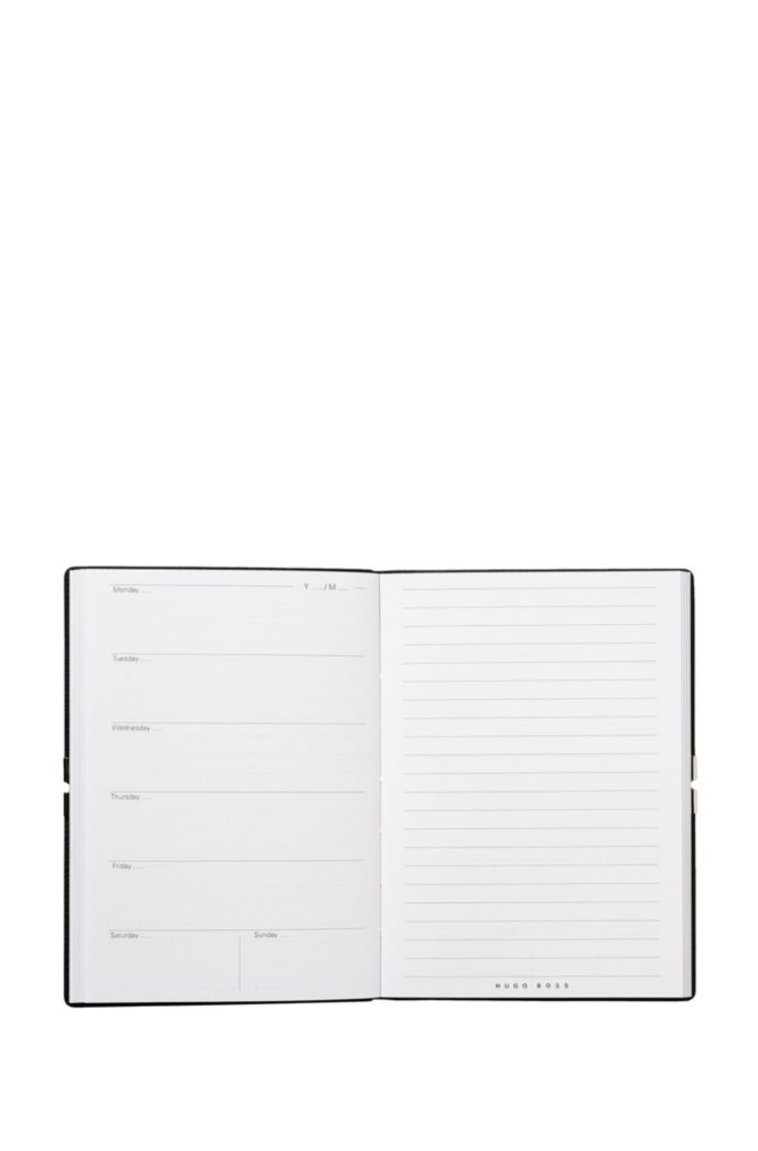 A6 notepad with black textured faux-leather cover