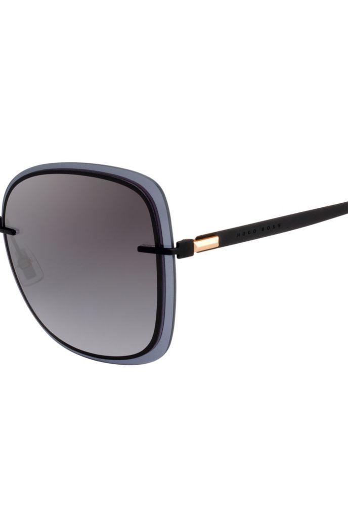 Zwarte zonnebril met transparante randen
