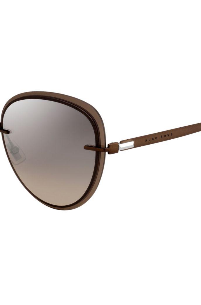 Bruine zonnebril met transparante randen
