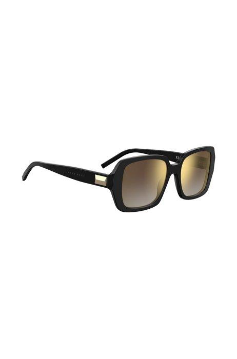Sonnenbrille aus schwarzem Acetat mit charakteristischen Metalldetails, Schwarz