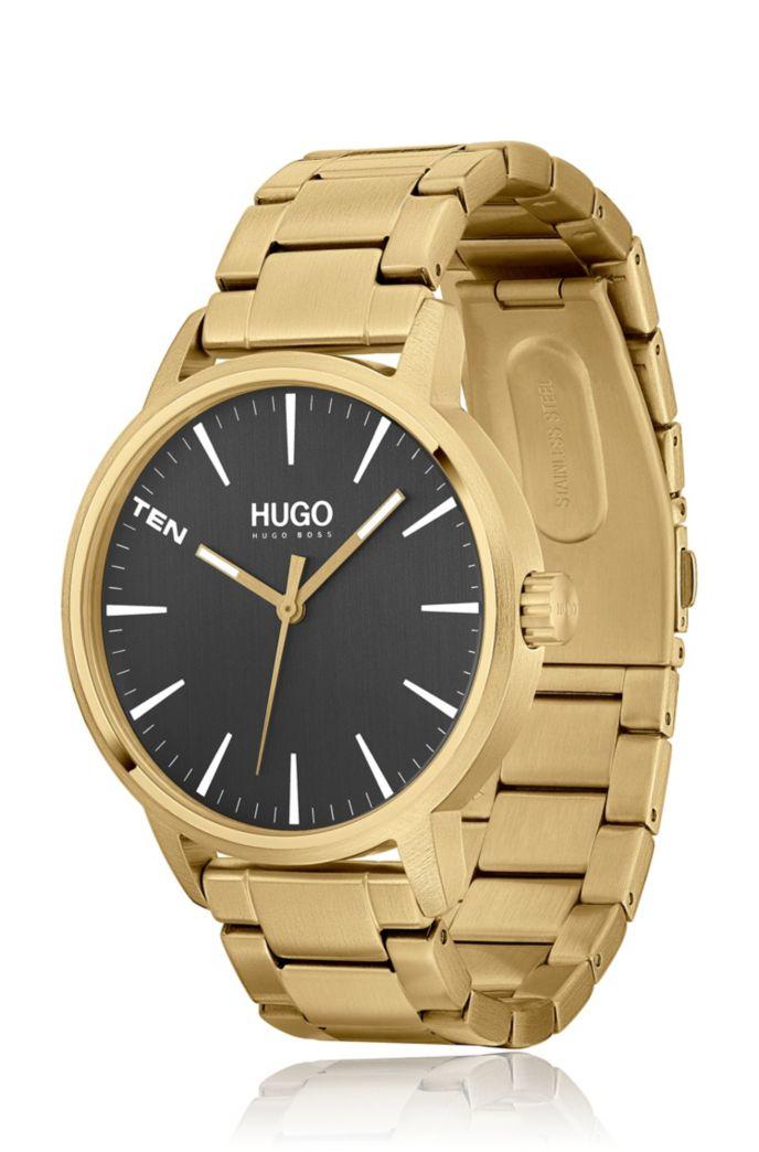 Horloge met contrasterende wijzerplaat en geschakelde polsband