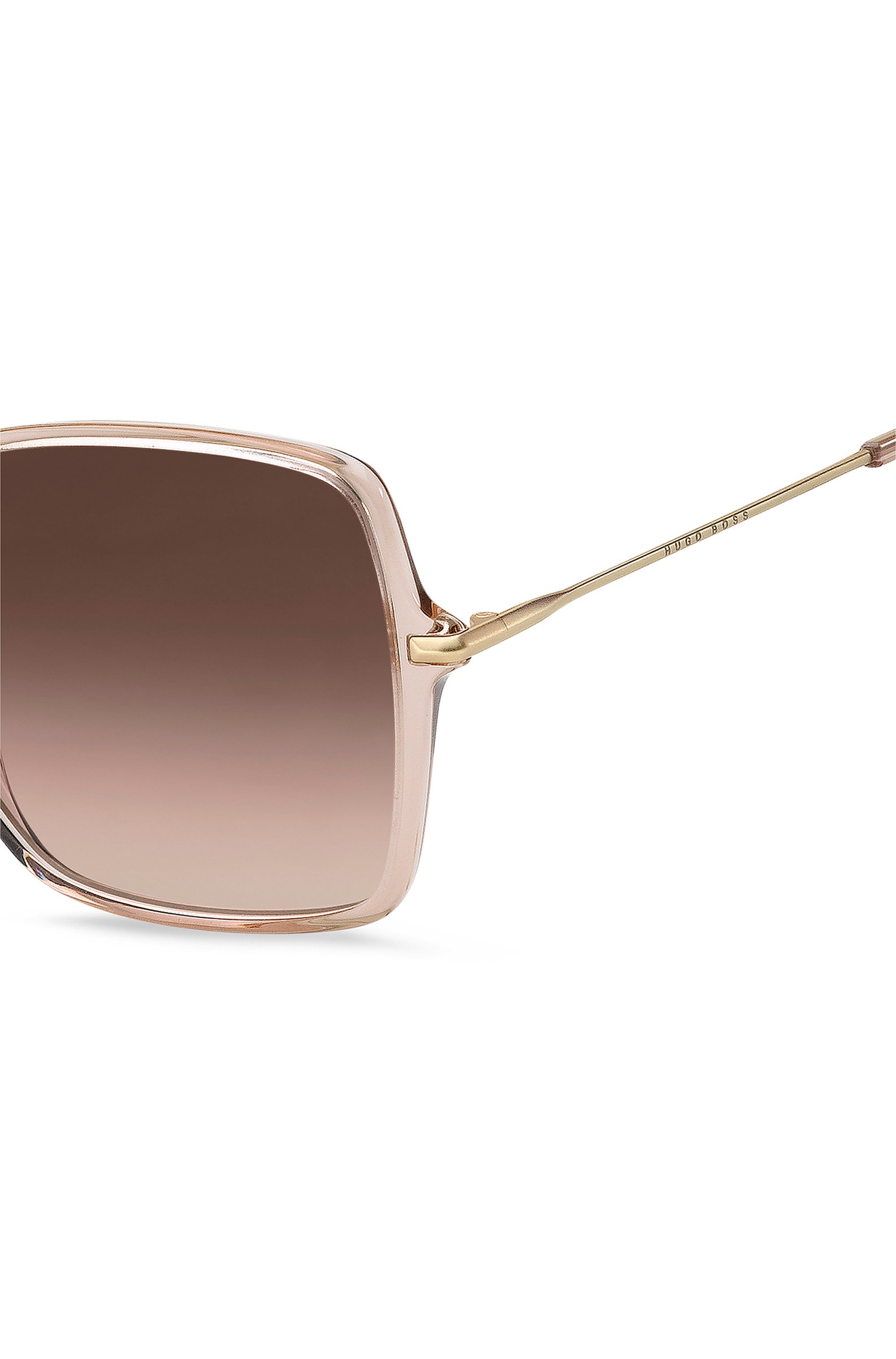 Sunglasses in nude acetate with brown shaded lenses