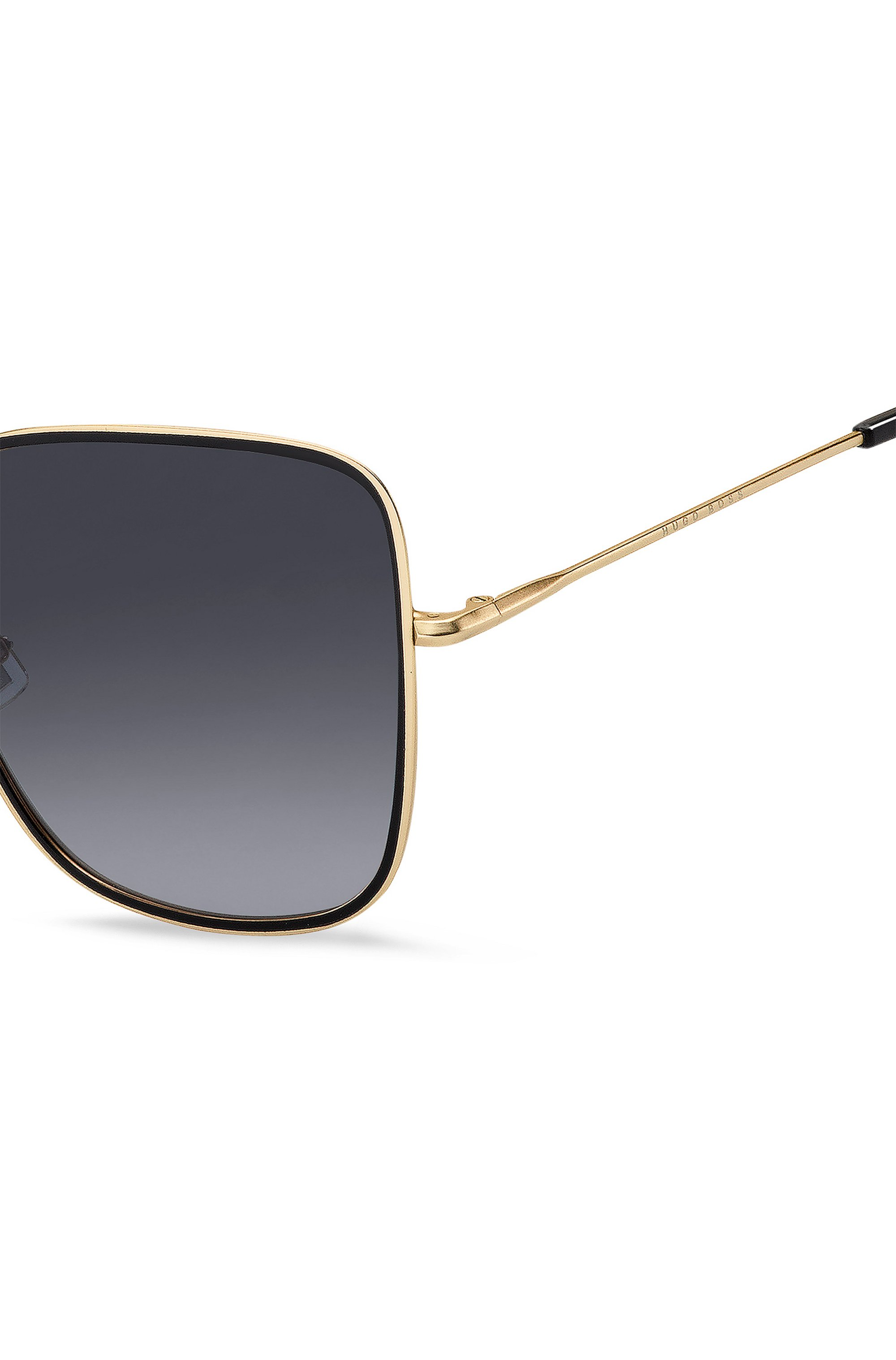Grey-shaded sunglasses with black and gold finishes