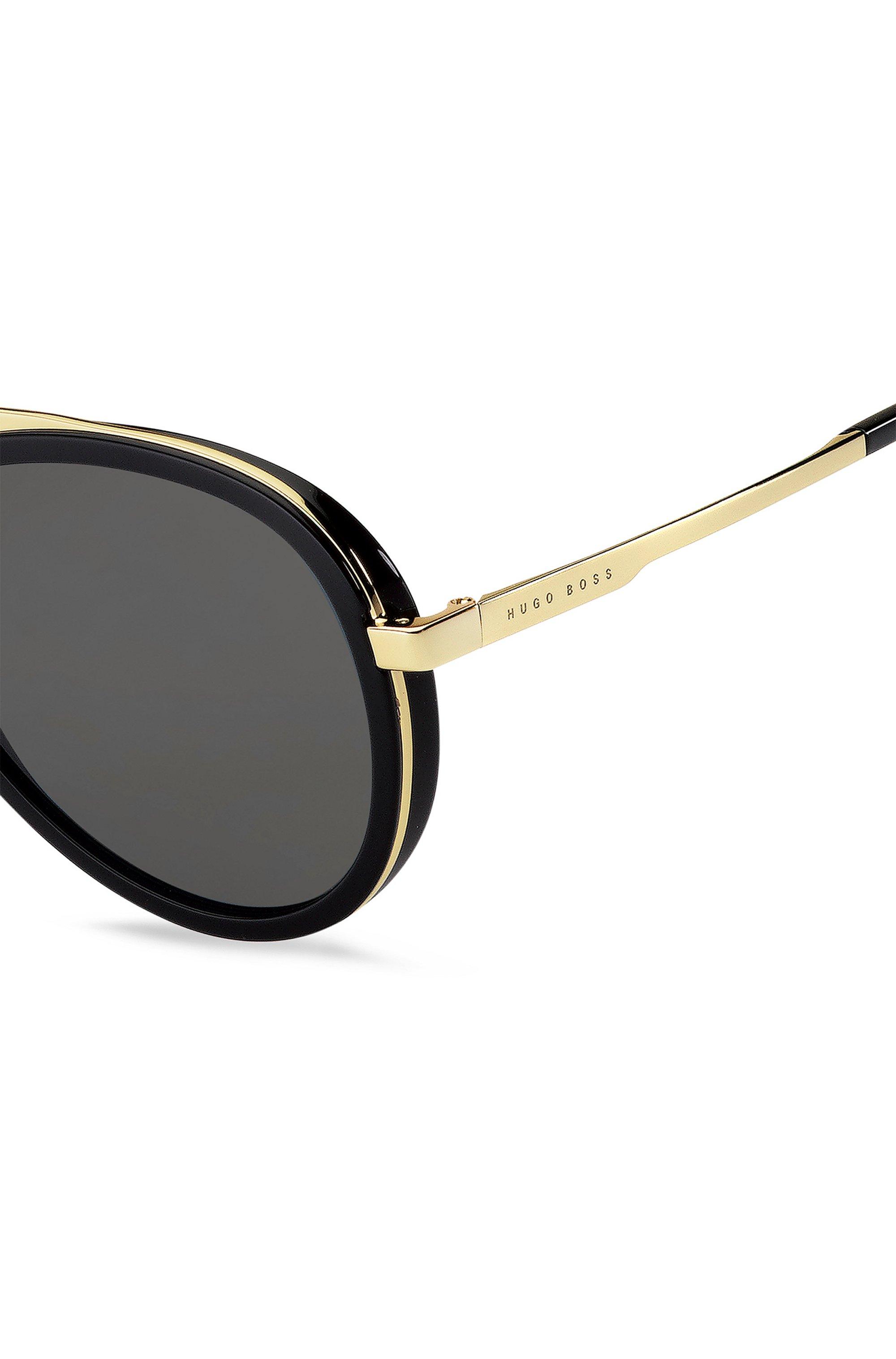 Triple-bridge sunglasses with black and gold-tone frames