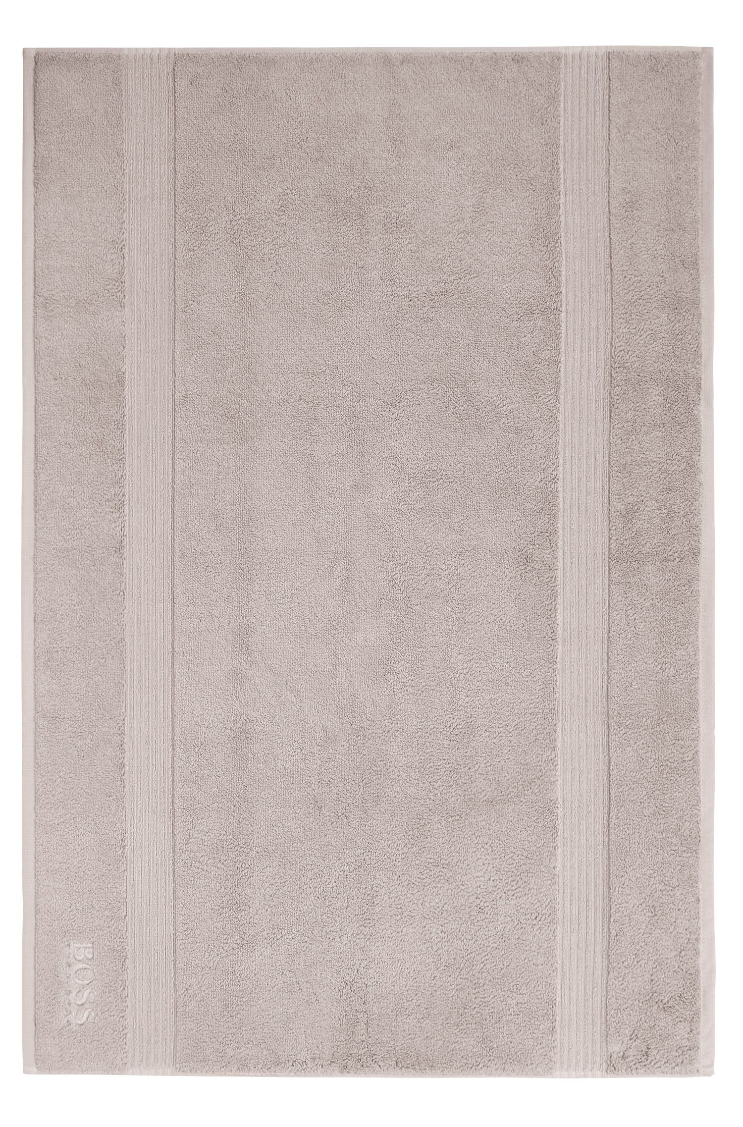 Bath mat in combed Aegean cotton with ribbed border