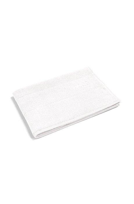 Finest Egyptian cotton bath mat with logo border, White