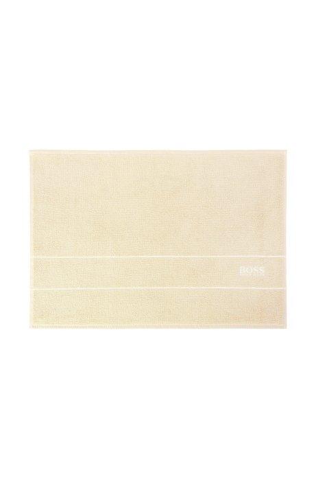 Finest Egyptian cotton bath mat with logo border, Light Beige