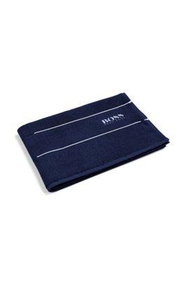 Finest Egyptian cotton bath mat with logo border, Dark Blue