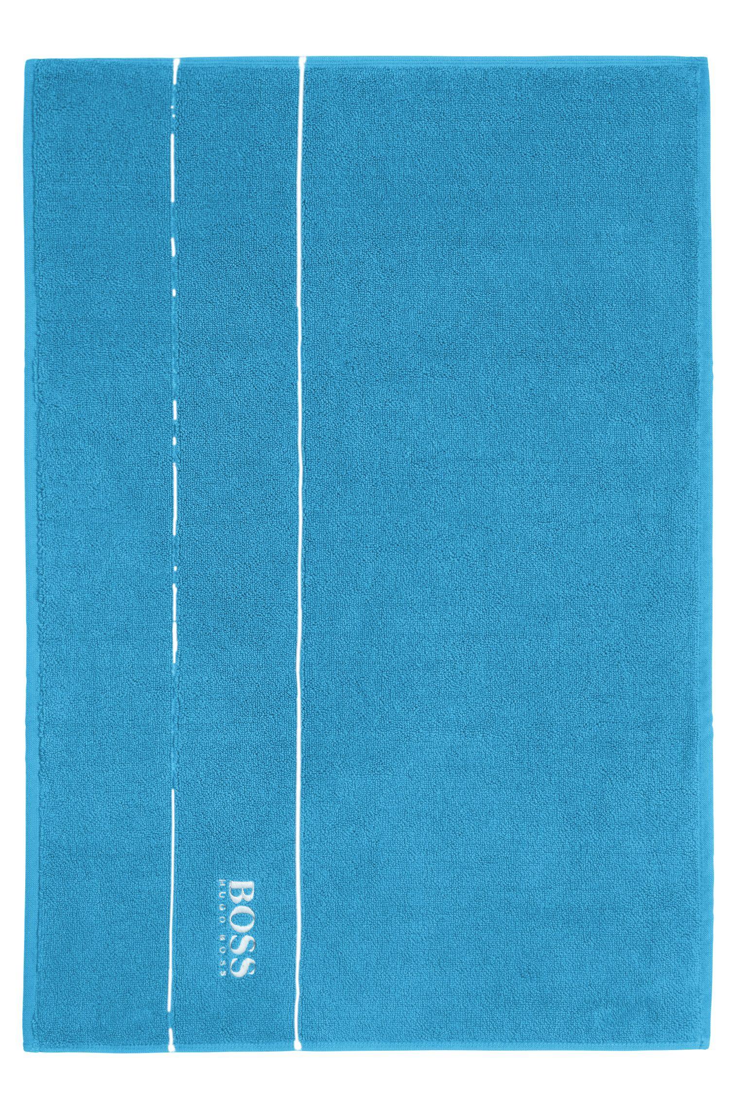 Tapis de bain en coton égyptien des plus raffinés avec bordure logo
