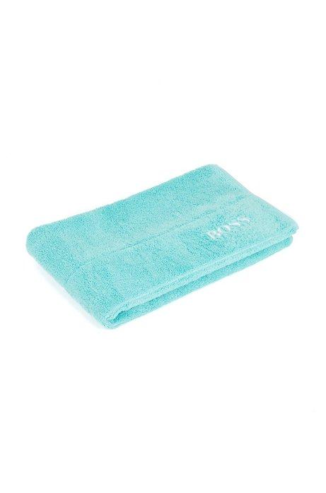 Finest Egyptian cotton bath mat with logo border, Turquoise