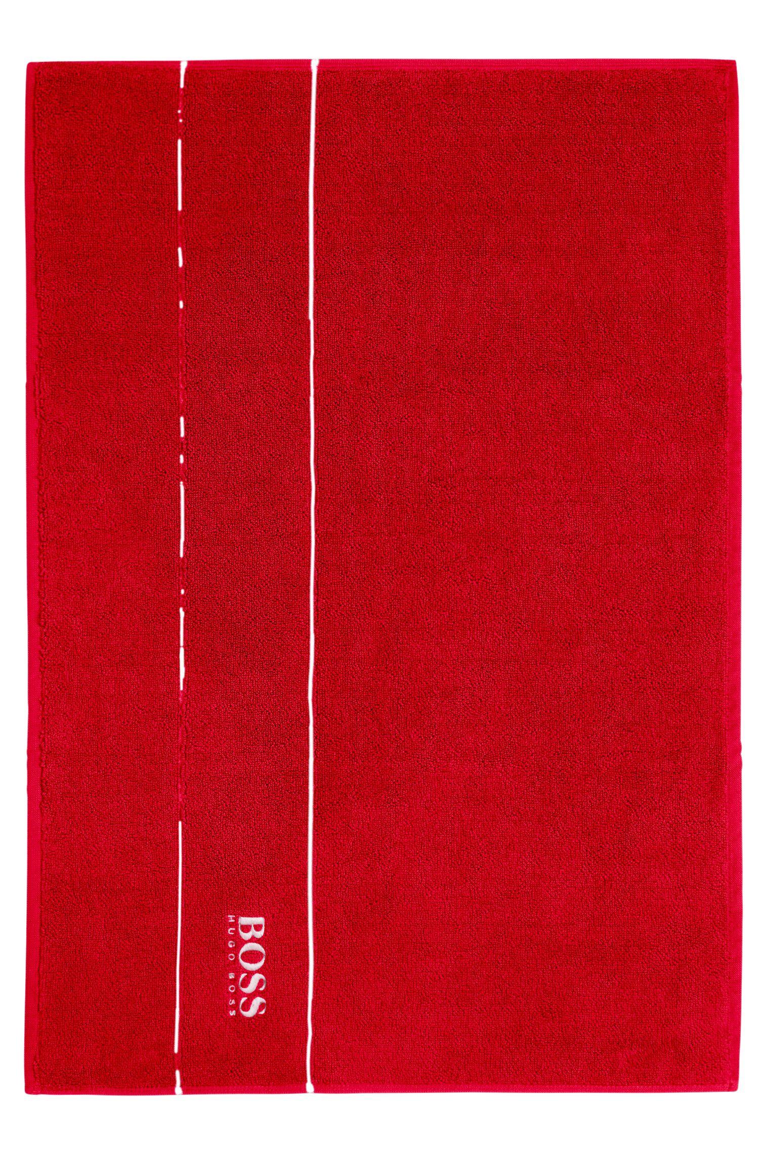 Badmat van de fijnste Egyptische katoen met rand met logo
