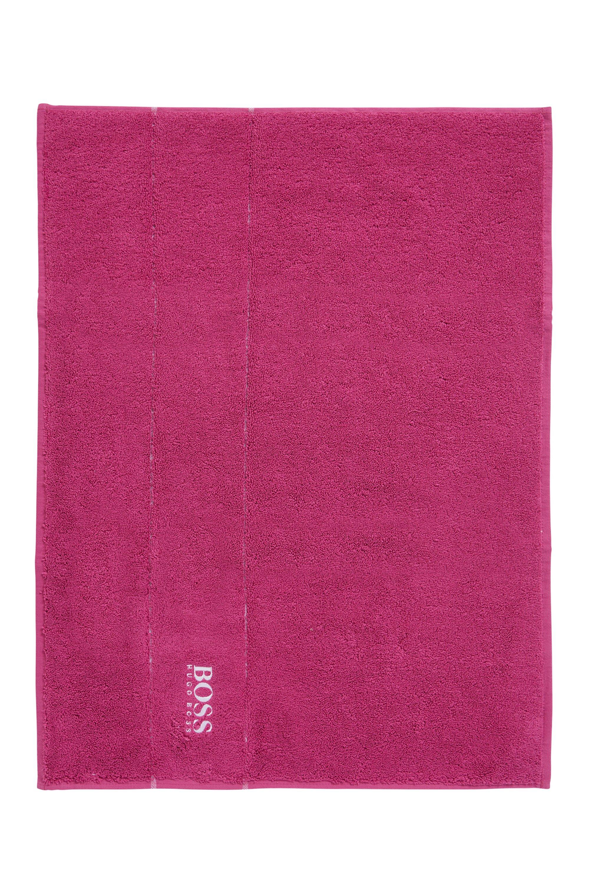 Finest Egyptian cotton bath mat with logo border