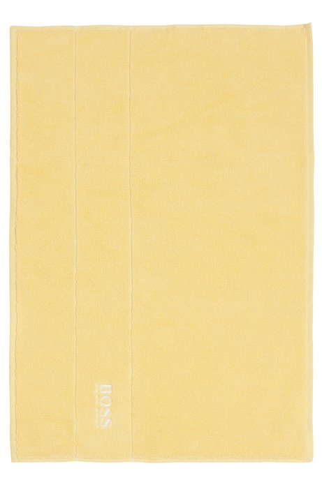 Finest Egyptian cotton bath mat with logo border, Light Yellow