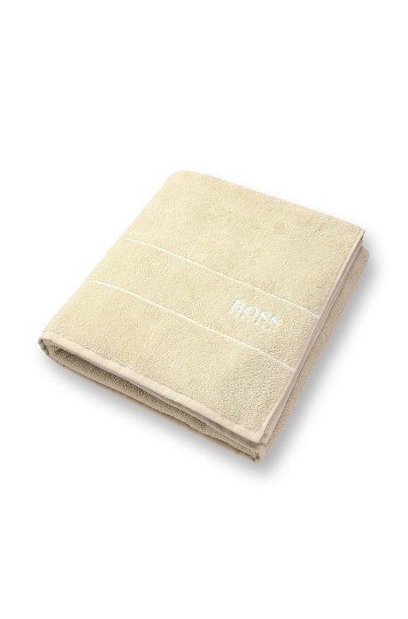 Finest Egyptian cotton bath sheet with logo border, Light Beige
