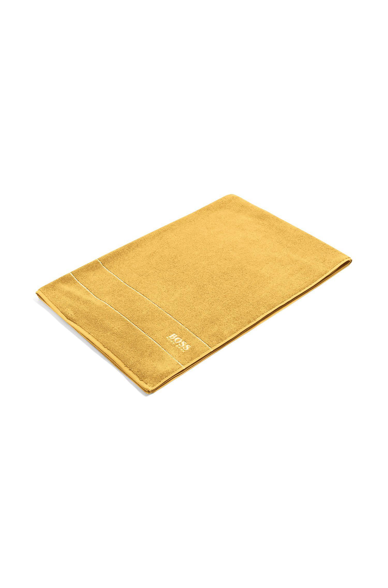 Toalla de baño extragrande en algodón egipcio de la máxima calidad con logo en el borde, Oro