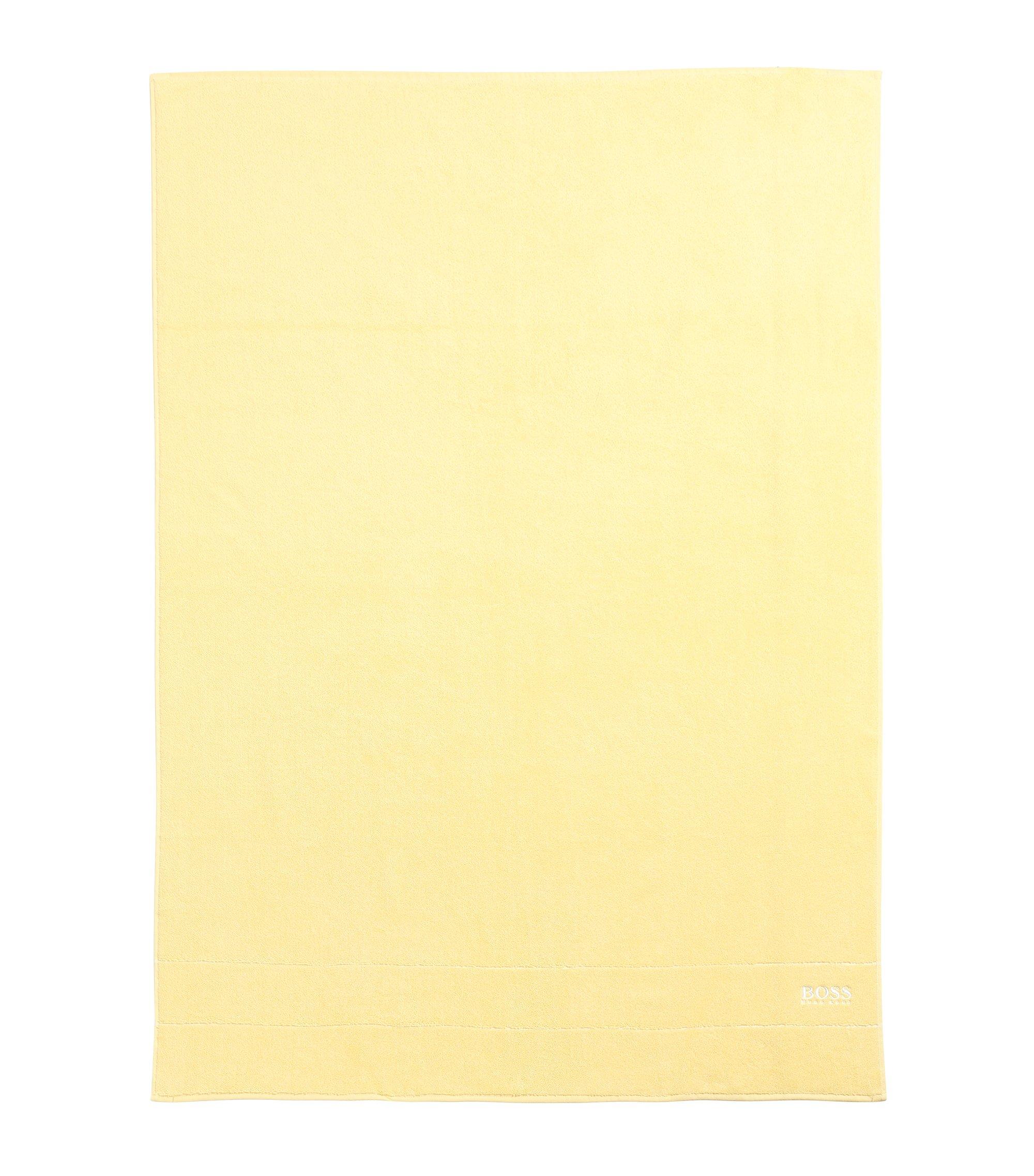Toalla de baño extragrande en algodón egipcio de la máxima calidad con logo en el borde, Amarillo claro