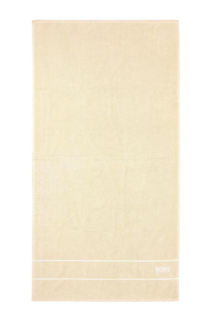 Asciugamano da bagno in raffinato cotone egiziano con bordo con logo