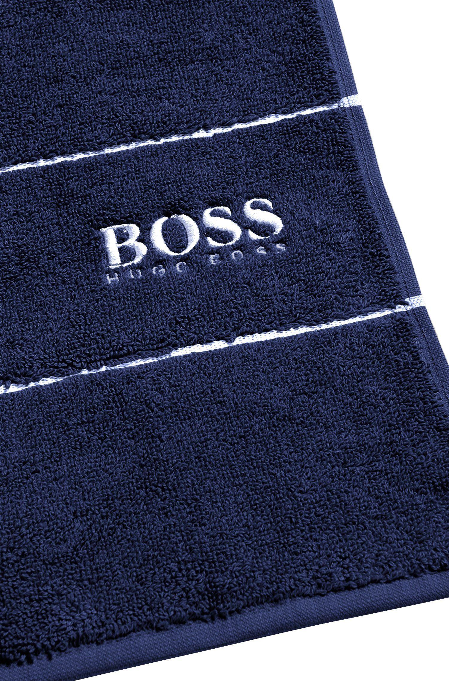 Serviette de bain en coton égyptien des plus raffinés avec bordure logo, Bleu foncé
