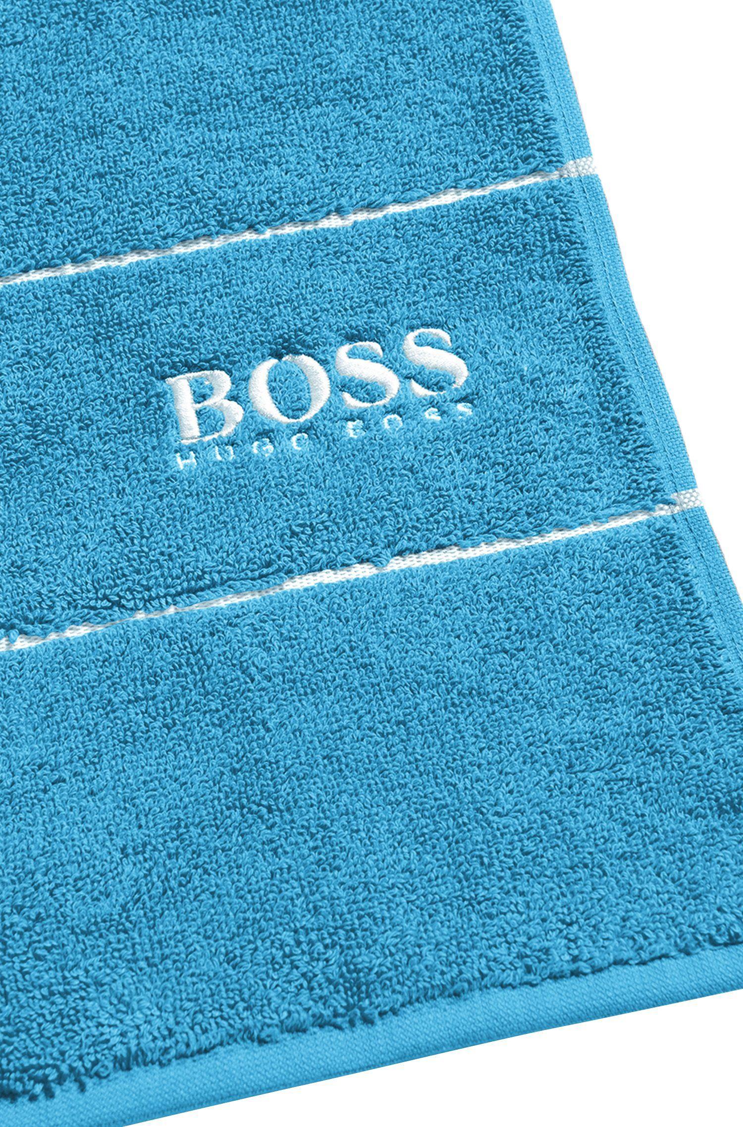 Badhanddoek van de fijnste Egyptische katoen met rand met logo, Blauw