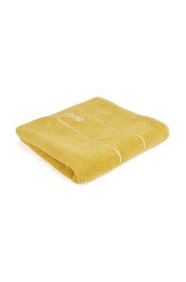 Badhanddoek van de fijnste Egyptische katoen met rand met logo, Geel