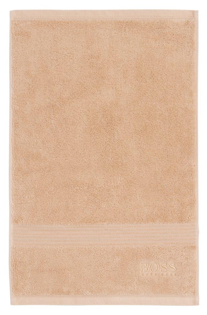 Gastenhanddoek van gekamde Egeïsche katoen met geribde rand
