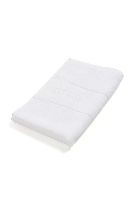 Finest Egyptian cotton guest towel with logo border, White