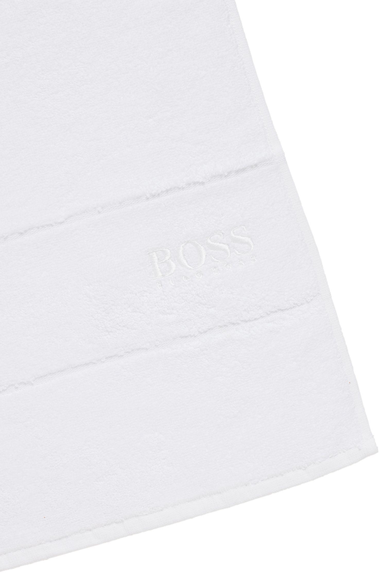 Serviette de toilette pour invité en coton égyptien des plus raffinés avec bordure logo, Blanc