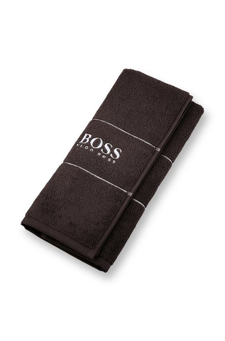 Finest Egyptian cotton guest towel with logo border, Dark Brown