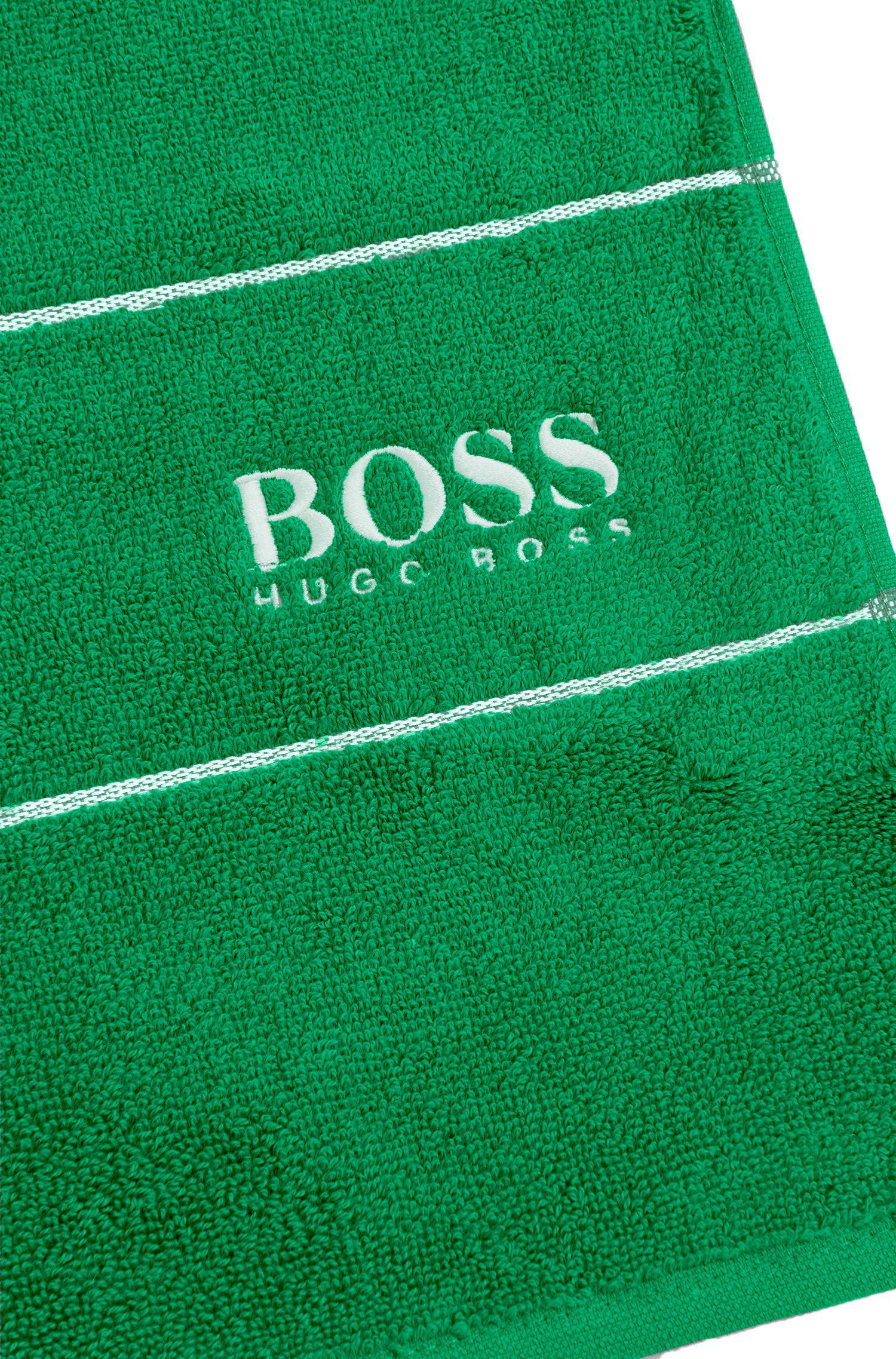 Serviette de toilette pour invité en coton égyptien des plus raffinés avec bordure logo