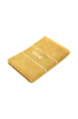 Finest Egyptian cotton guest towel with logo border, Yellow