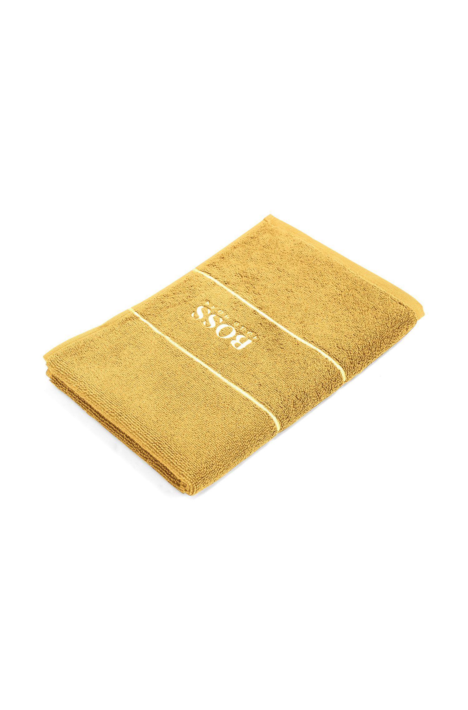 Serviette de toilette pour invité en coton égyptien des plus raffinés avec bordure logo, Or