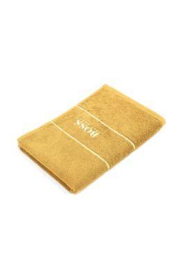 Toalla para invitados en algodón egipcio de la máxima calidad con logo en el borde, Oro