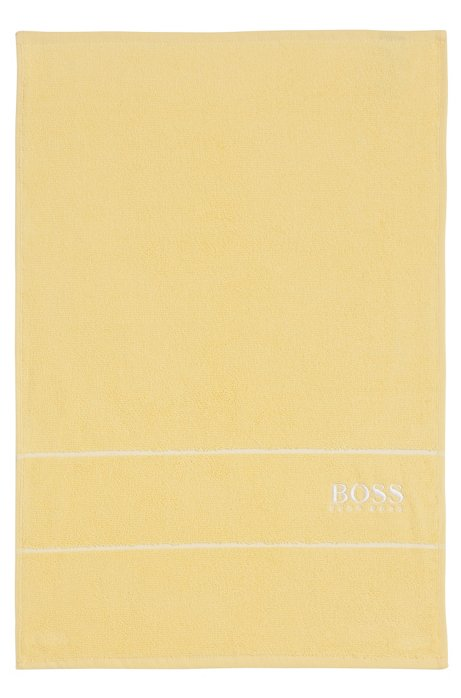 Finest Egyptian cotton guest towel with logo border, Light Yellow