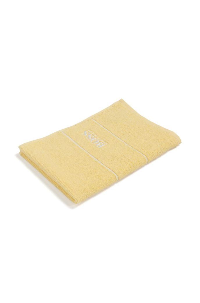 Asciugamano per ospiti in pregiato cotone egiziano con bordo con logo