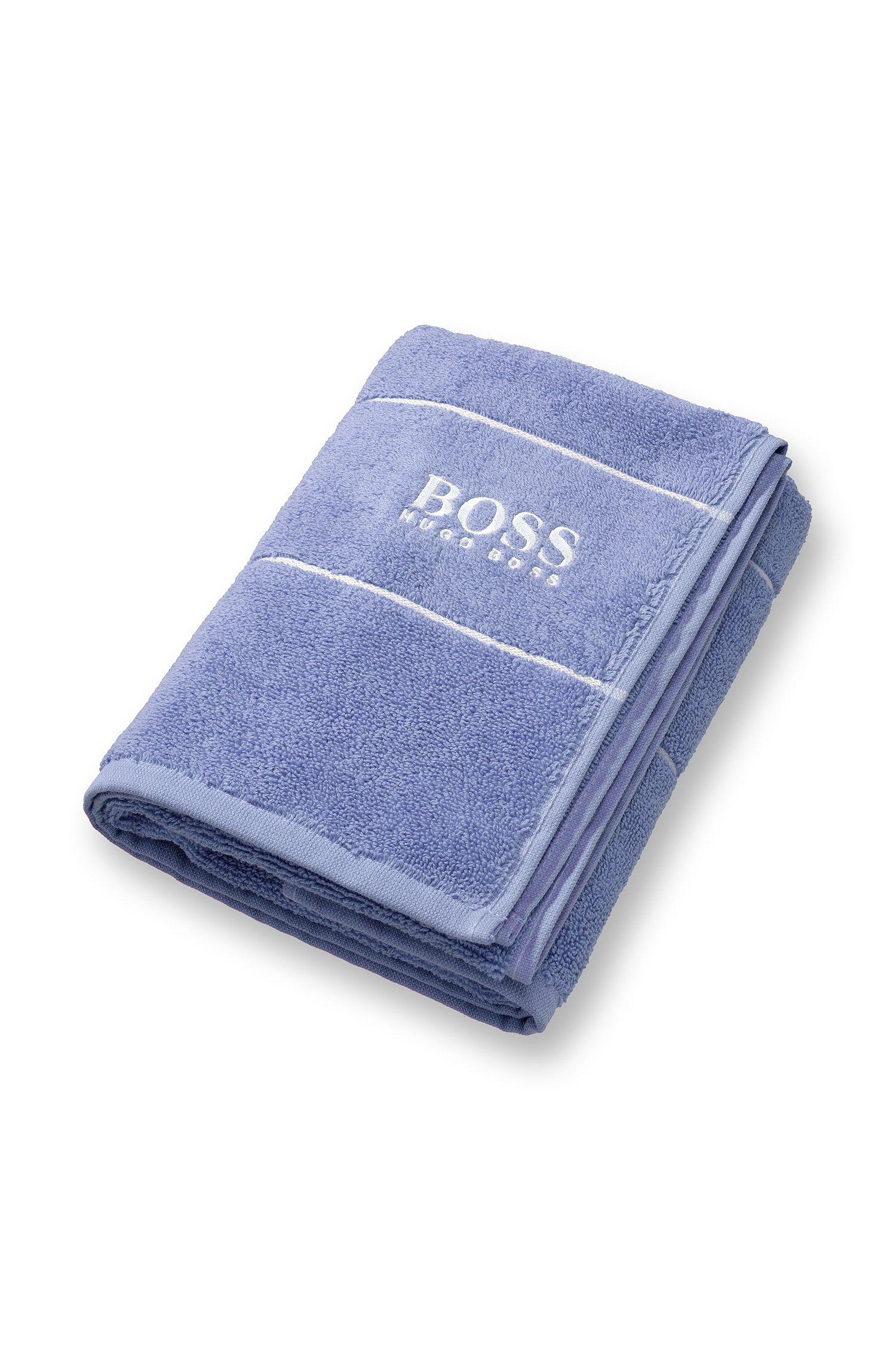 Toalla de mano en algodón egipcio de la máxima calidad con logo en el borde, Azul