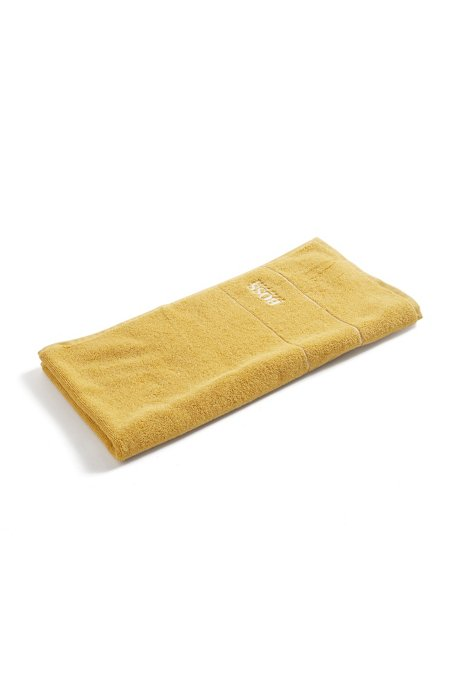 Finest Egyptian cotton hand towel with logo border, Yellow