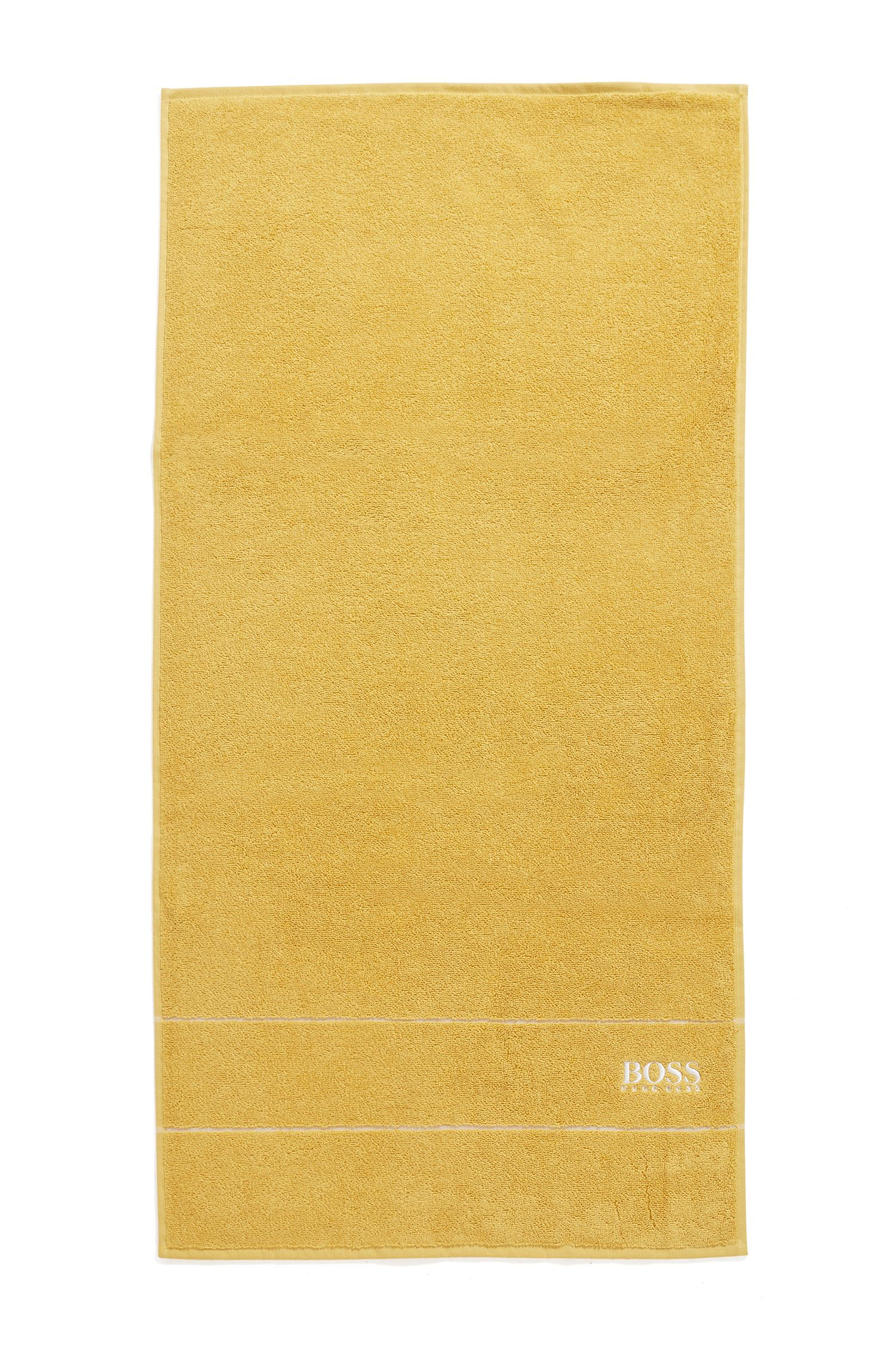 Finest Egyptian cotton hand towel with logo border, Gold