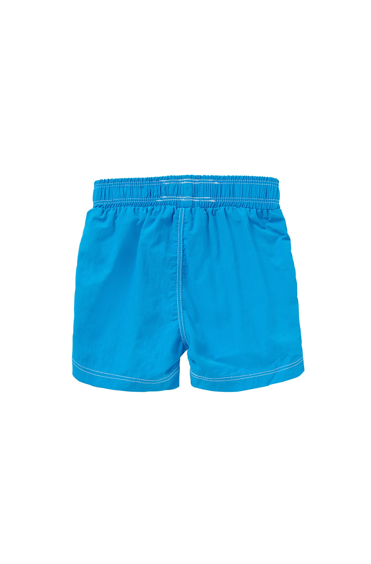 Kids' swim shorts with large logo print: 'J04228'