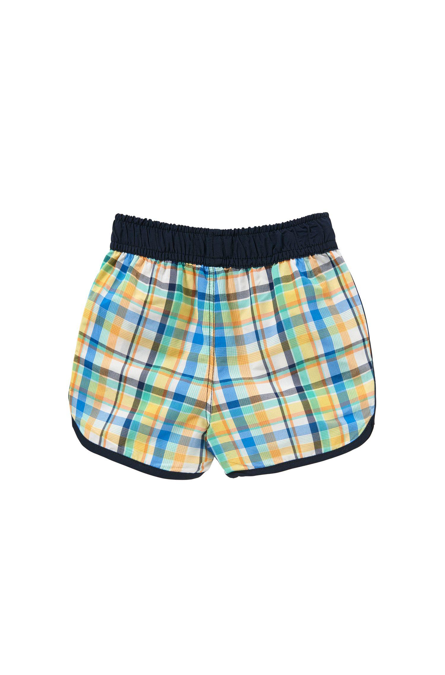 Checked newborns' swim shorts with drawstring waistband: 'J04230'