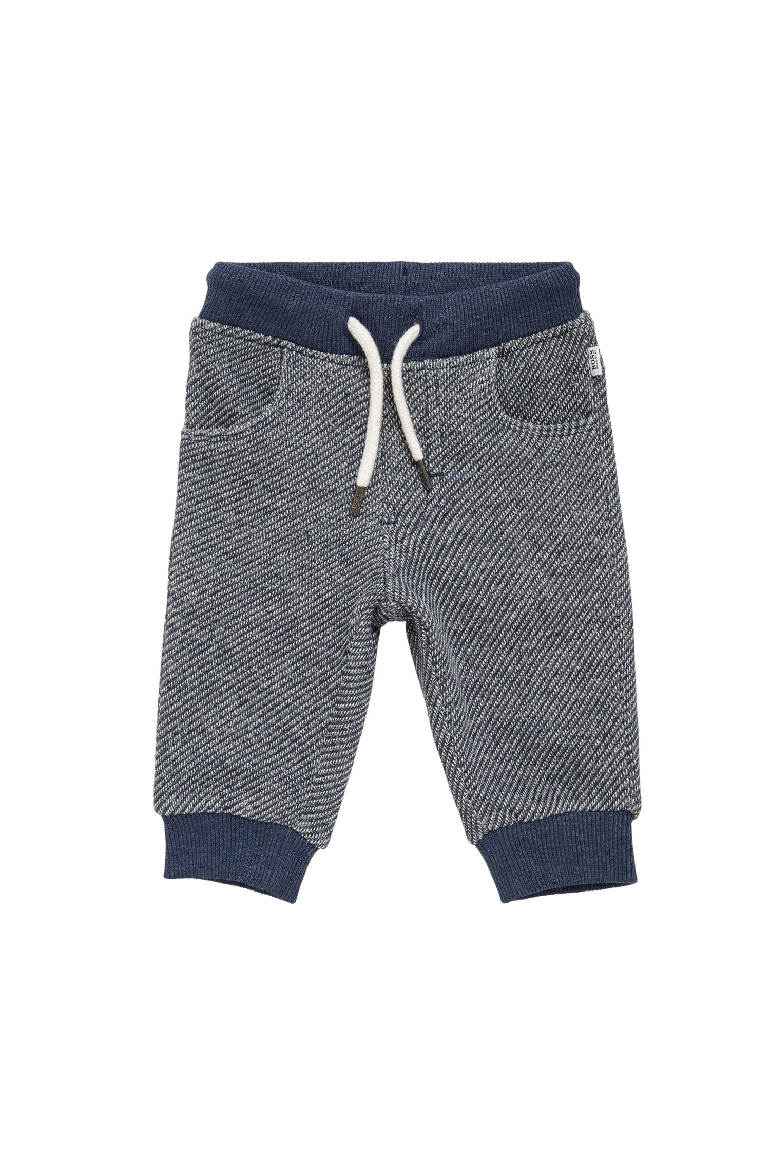 Kids' tracksuit bottoms in cotton with a drawstring waistband: 'J04245'