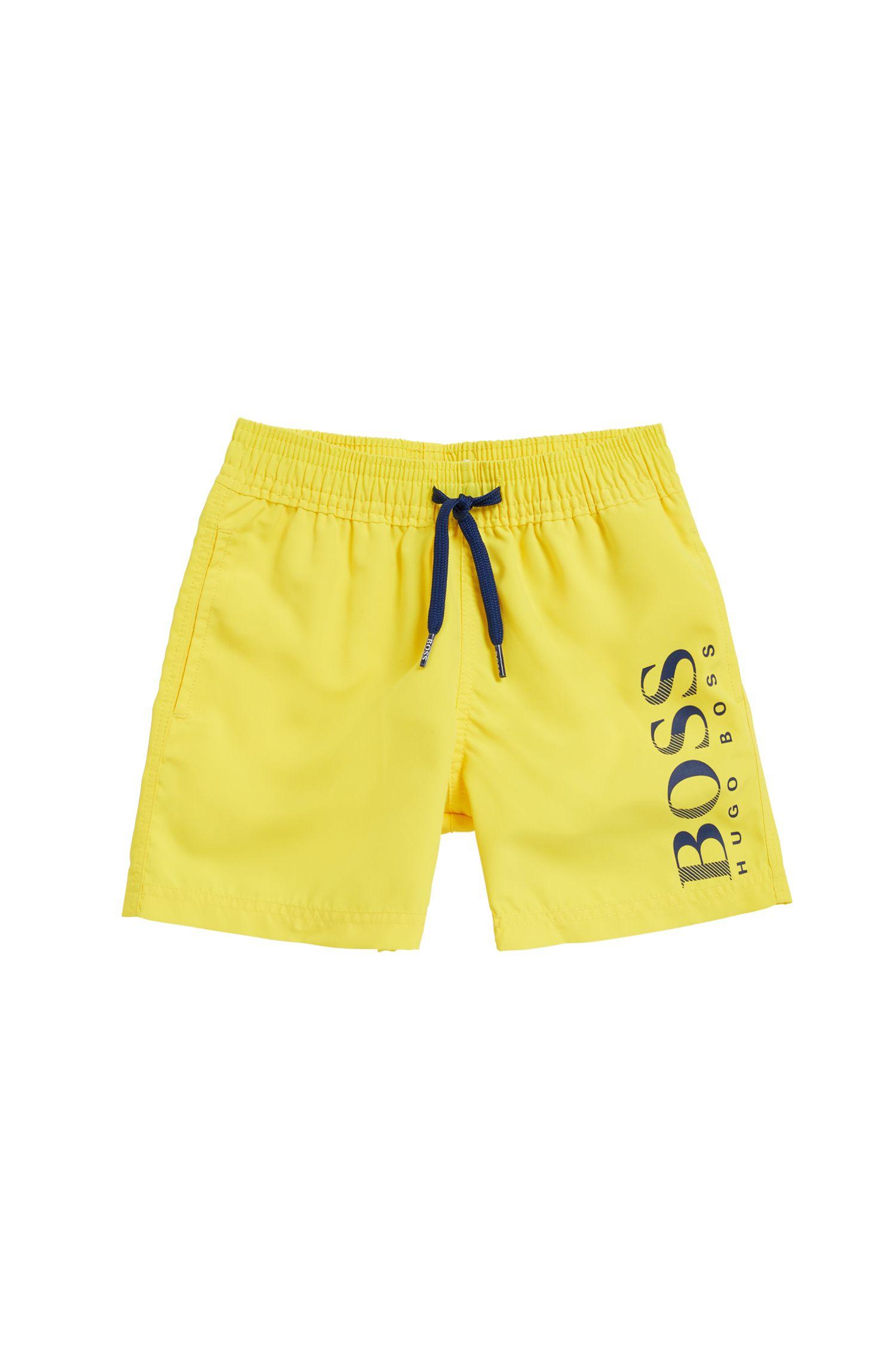 Kids' quick-dry swim shorts with logo print