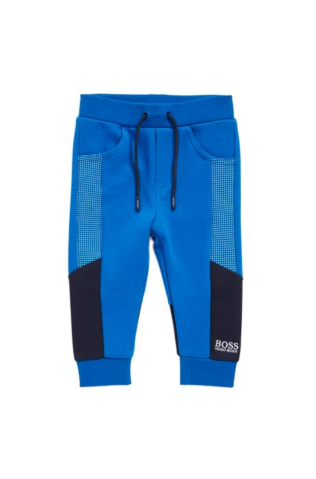Kids' tracksuit trousers with logo embroidery, Blue