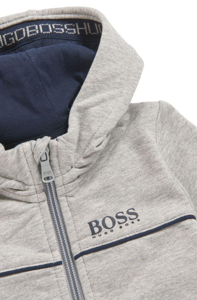 Une veste d'intérieur pour enfant à capuche, en molleton de coton stretch