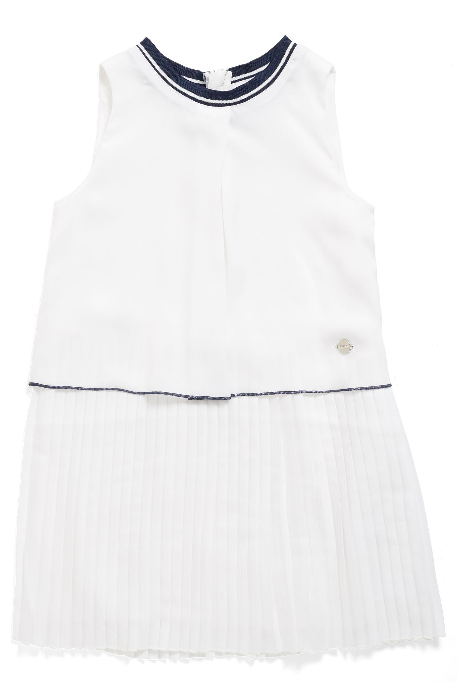 Mouwloze kinderjurk met plissérok, Wit